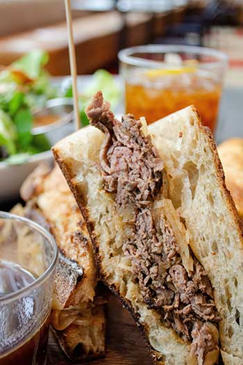The Durham Hotel North Carolina Travel Guide French Dip Sandwich Image